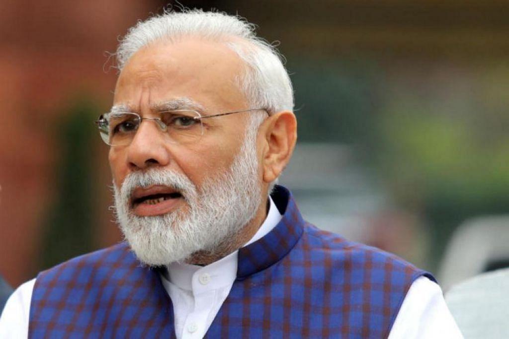 Dalam foto yang diambil pada 18 November, Perdana Menteri India Encik Narendra Modi bercakap kepada media dalam premis Parlimen di New Delhi. - Foto Reuters