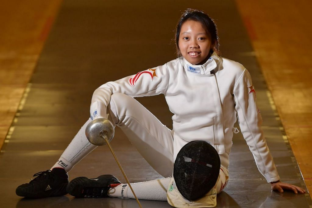 HARUMKAN NAMA NEGARA: Walaupun kali pertama bertanding dalam Sukan SEA, Kiria megharumkan nama negara apabila beliau memenangi pingat emas kedua Singapura dalam sukan lawan pedang. - Foto BH oleh LIM YAOHUI