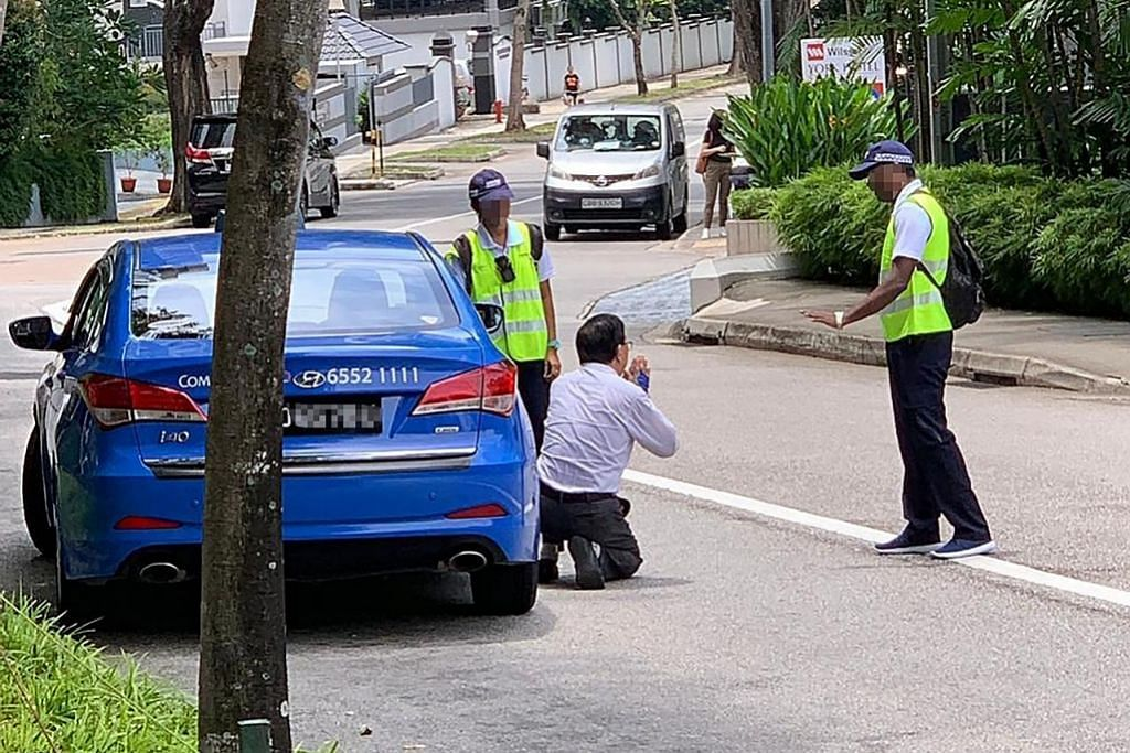 Pemandu teksi melutut mohon usah didenda kerana merokok
