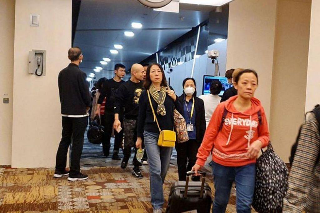 VIRUS MISTERI WUHAN: Alat periksa suhu badan di Lapangan Terbang Changi dipasang bagi memeriksa suhu badan orang ramai yang tiba di Singapura dari Wuhan, China.