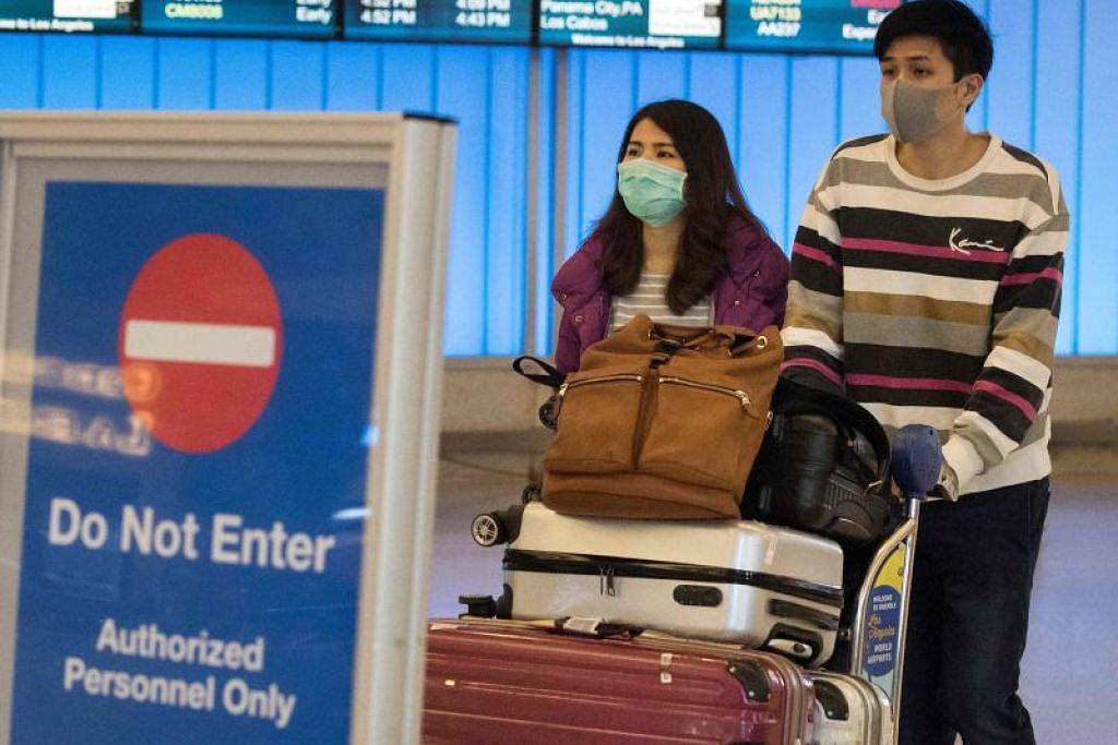 KAWAL PENULARAN: Pembatalan penerbangan dari Wuhan diharap dapat membendung penularan virus.