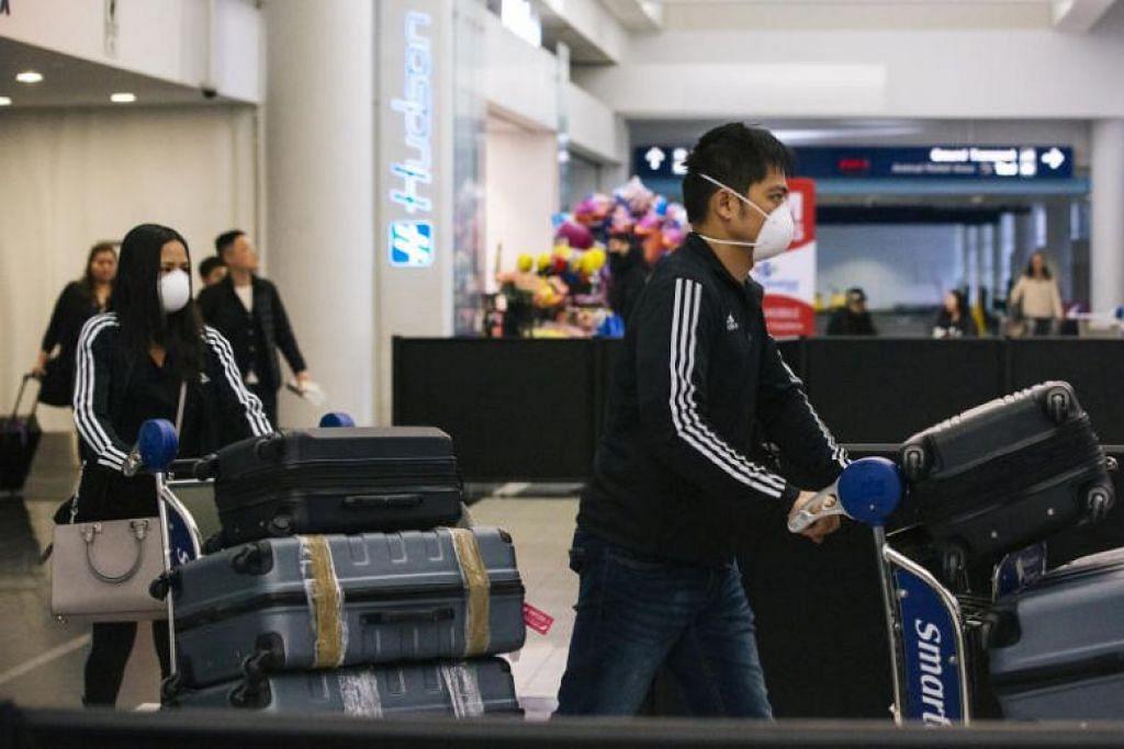 Para pelawat tiba di Lapangan Terbang Antarabangsa O'Hare di Chicago, AS. FOTO: NYTIMES