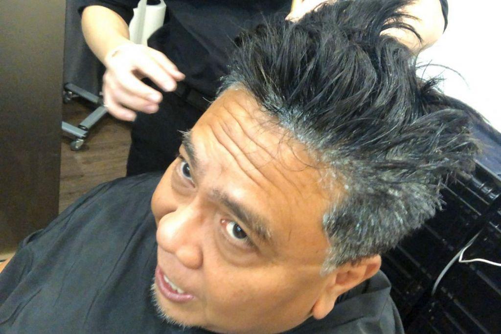 PENGGUNAAN MASKER; Masker rambut disapu pada kulit kepala Suhaimi Yusof untuk memperkukuh akar-akar rambut