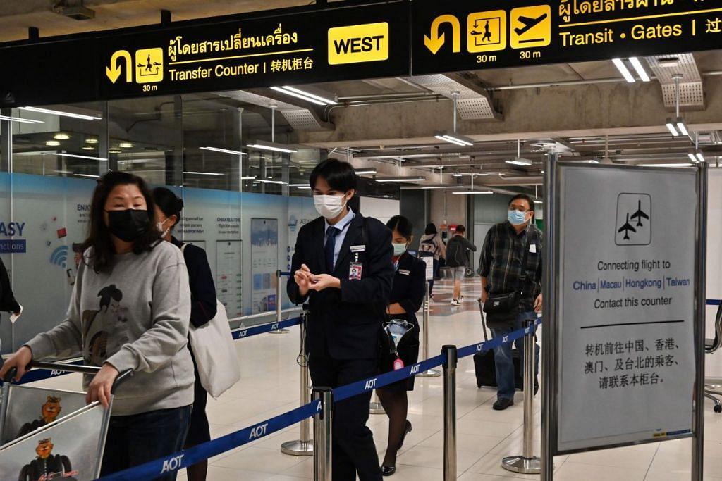 DISURUH PULANG: Pelancong yang gagal memberi alamat yang sah di Thailand akan disuruh pulang ke negara asal mereka. - Foto: AFP