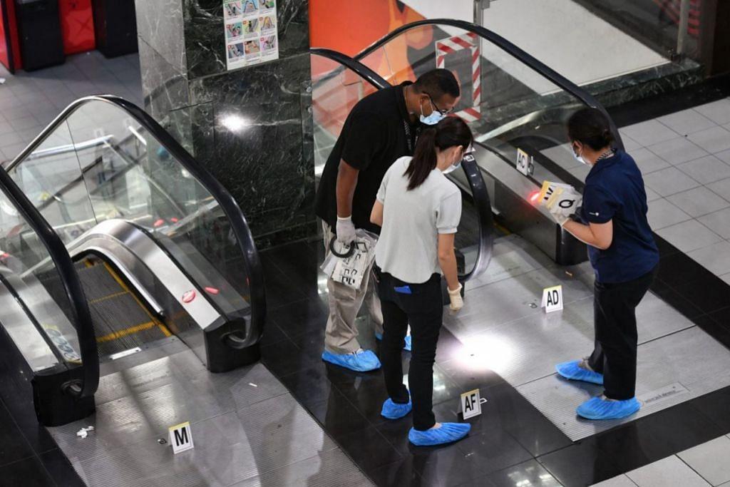 SIASAT: Pegawai polis menyiasat jenayah di Orchard Towers pada 2 Julai 2019 - Foto fail