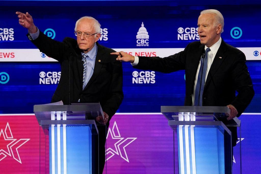 PERBAHASAN ANTARA POTENSI CALON: Potensi calon Demokratik, Ahli Senat Vermont, Encik Bernie Sanders (kiri) dan bekas Naib Presiden Encik Joe Biden dalam satu perbahasan pada 25 Februari 2020. - Foto AFP