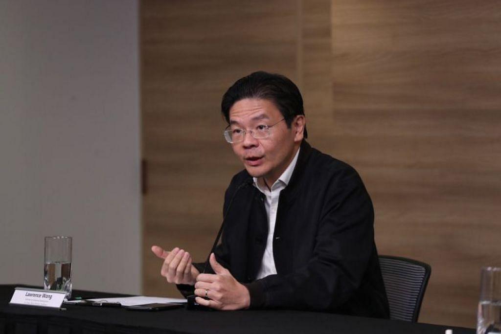 TUNDA RANCANGAN KE LUAR NEGARA: Menteri Pembangunan Negara, Encik Lawrence Wong, meminta orang ramai menangguhkan rancangan perjalanan ke luar negara buat masa ini.