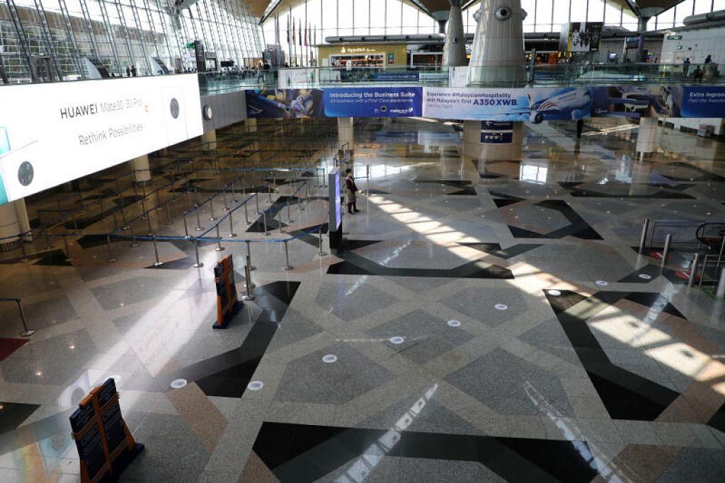 KOSONG: Lapangan Terbang Antarabangsa Kuala Lumpur lengang pada 18 Mac 2020, setelah kerajaan Malaysia menghalang kemasukan warga asing.