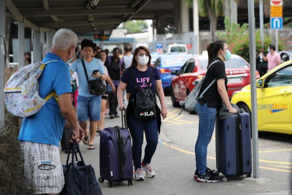 BOLEH TERUS KERJA: Warga Malaysia yang mempunyai permit kerja Singapura boleh terus bekerja di Singapura dengan pemeriksaan kesihatan dan tempat penginapan.