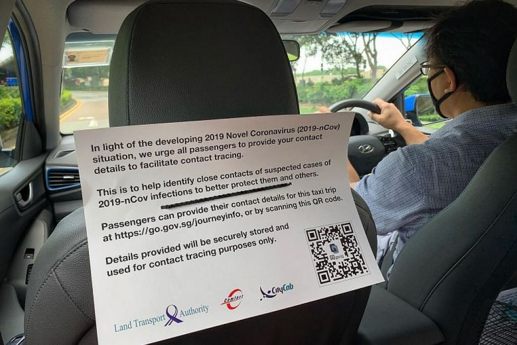 LANGKAH KESELAMATAN KESIHATAN: Satu notis di teksi ComfortDelGro semalam meminta penumpang untuk memberikan maklumat hubungan mereka untuk perjalanan. Semua teksi akhirnya akan mempunyai kod QR, yang dilancarkan di seluruh industri mulai hari ini.