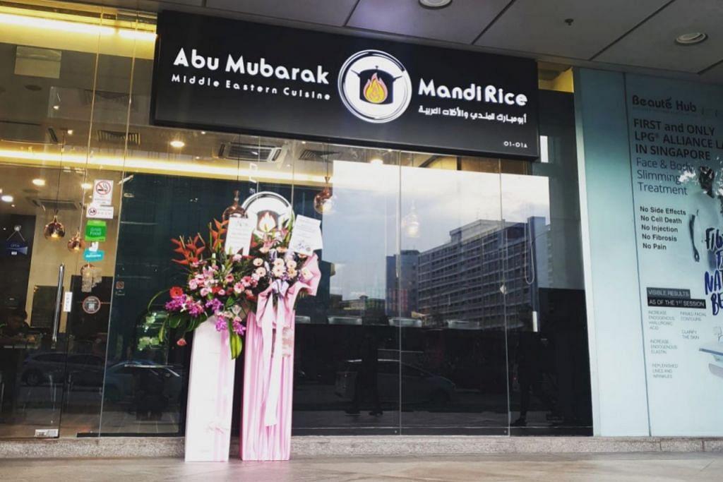 BARU DIBUKA SEBELUM PEMUTUS LITAR: Restoran Abu Mubarak Mandi Rice baru dibuka pada 1 April lalu di bangunan Income at Tampines Junction tetapi terpaksa ditutup buat sementara waktu selepas langkah pemutus litar berkuat kuasa. – Foto ABU MUBARAK MANDI RICE