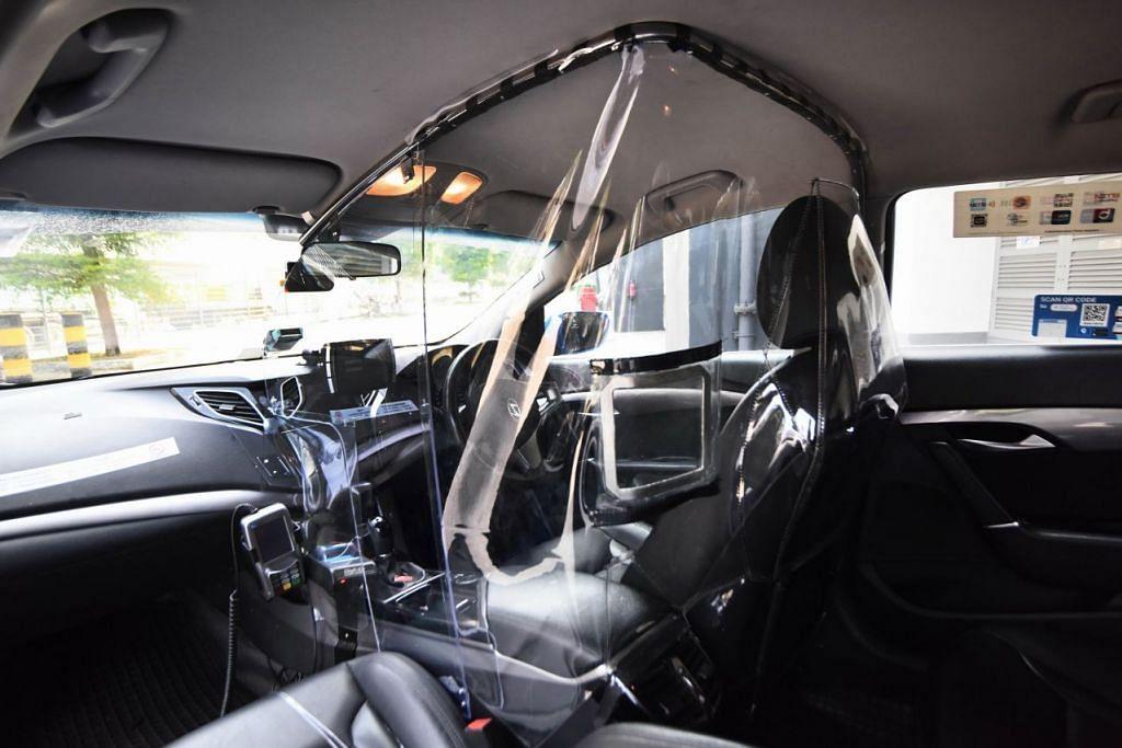 """PELINDUNG KESELAMATAN: Disebut 'Perisai V', perisai buatan tempatan telah didaftarkan hakciptanya oleh Moove Media. Berukuran 1m x 0.7m x 0.6m, 'Perisai V' melindungi seluruh kabin pemandu, dan mempunyai dua """"tingkap"""" bukaan untuk penumpang membuat pembayaran."""