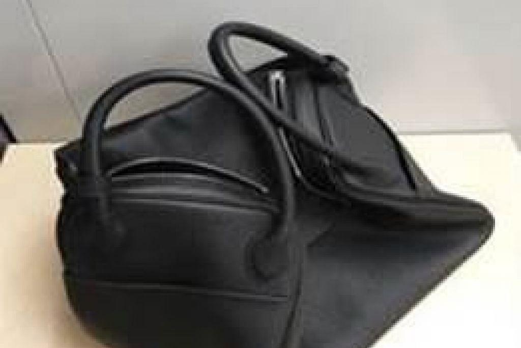 BEG MEWAH PALSU: Siasatan awal menunjukkan tiga individu yang diberkas itu terlibat dalam sekurang-kurangnya tujuh kes penipuan penjualan beg mewah berjumlah $9,800.