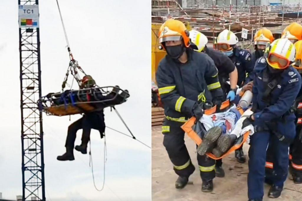 BERJAYA DISELAMATKAN: Pasukan SCDF telah berjaya menyelamatkan lelaki yang tercedera atas kren di ketinggian 40 meter. – Foto-foto SCDF