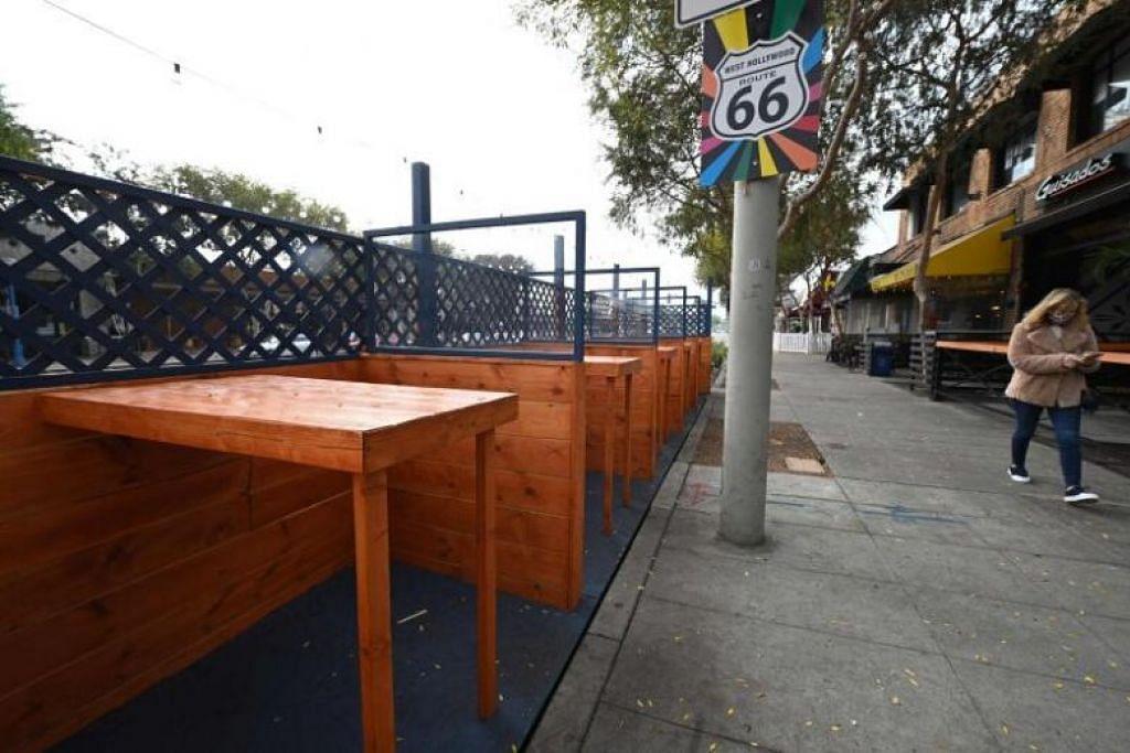 WABAK YANG BELUM REDA: Hampir 388,000 kes Covid-19 disahkan di wilayah Los Angeles sejauh ini lantas memerlukan langkah berjaga-jaga diperketatkan. - Foto AFP