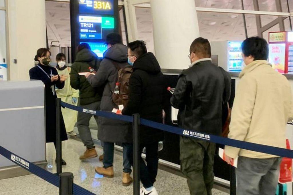 PENERBANGAN PULANG: Seramai 92 warga Singapura menaiki penerbangan Scoot dari Wuhan ke Singapura pada 30 Januari lalu.