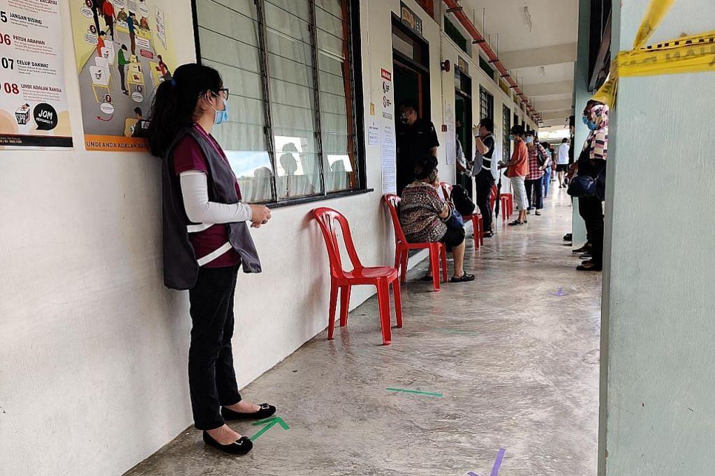 Warga Sabah buang undi, patuhi langkah selamat
