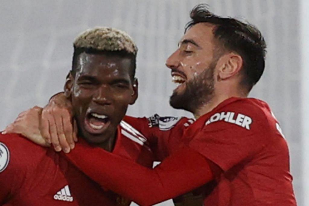 DUA PASAK KEKUATAN MAN U: Paul Pogba (kiri) dan Bruno Fernandes. - Foto AFP
