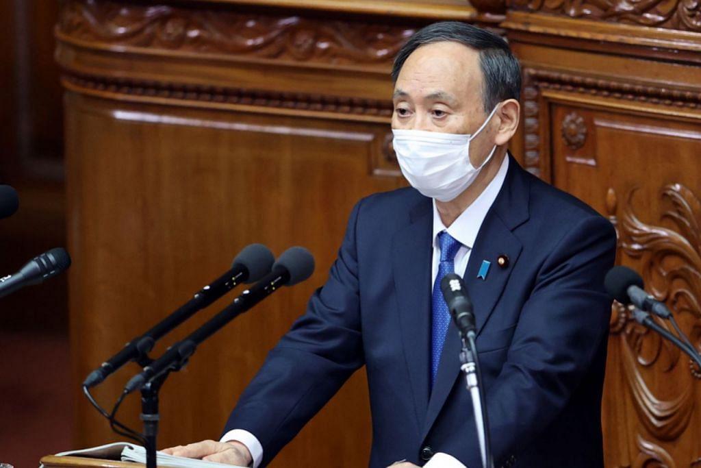 MASIH BERHARAP: Perdana Menteri Jepun Yoshihide Suga berkata Olimpik dan Paralimpik Tokyo akan terus diadakan pada musim panas ini, semasa berucap di Parlimen pada 18 Januari. - Foto EPA-EFE
