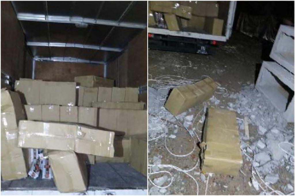Kotak karton, yang disyaki mengandungi rokok yang tidak dibayar cukai, dikeluarkan daripada blok konkrit yang dipukul menggunakan tukul. - Foto KASTAM SINGAPURA