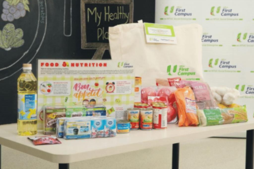 Pek makanan dengan keperluan seharian yang akan diagihkan. - Foto NTUC First Campus