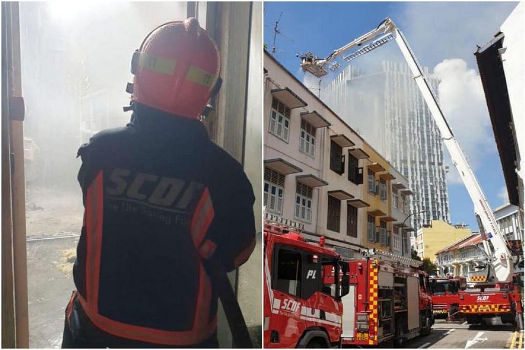 Pegawai SCDF cuba memadamkan api di rumah kedai di 31 Teo Hong Road di Outram Park pada 15 Jun 2021. - Foto-foto FACEBOOK/SINGAPORE CIVIL DEFENCE FORCE