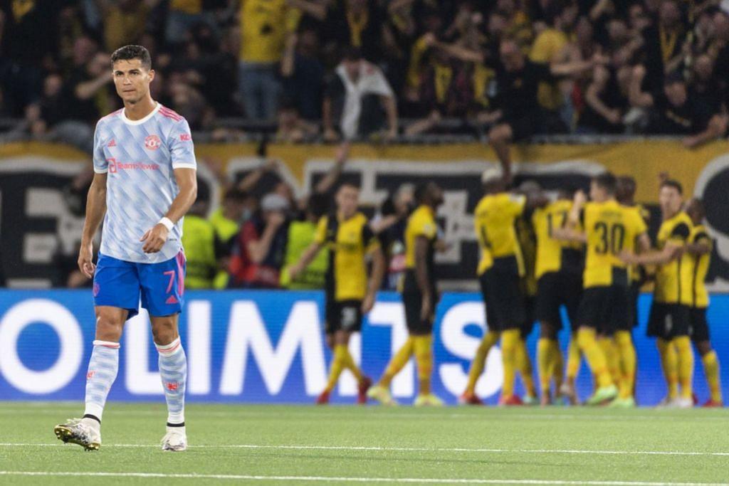 WAJAH HAMPA: Bintang United, Cristiano Ronaldo (gambar atas) meninggalkan padang dengan penuh kehampaan dengan para pemain Young Boys meraikan kemenangan mengejut. – Foto EPA-EFE