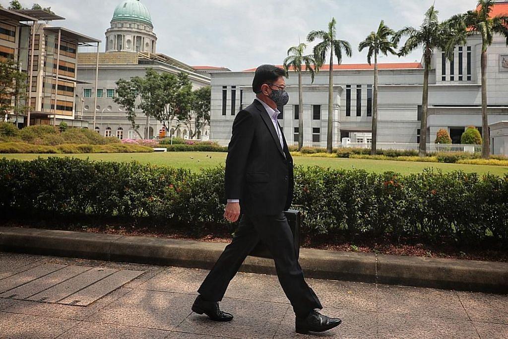 DPM Heng berjalan kaki ke Parlimen bentang bajet